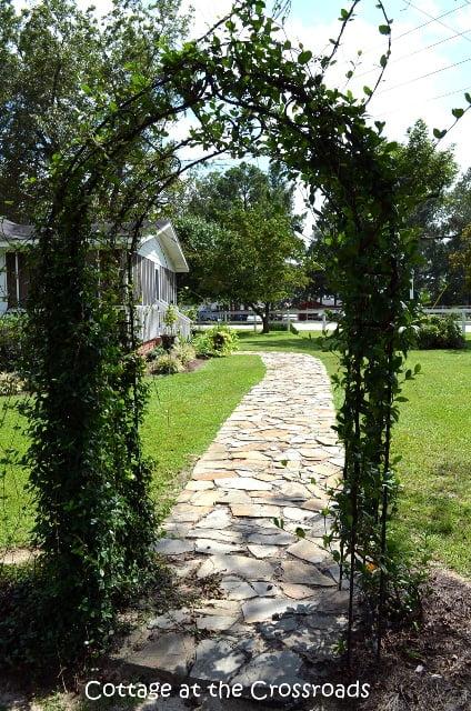 arbor and stone walkway