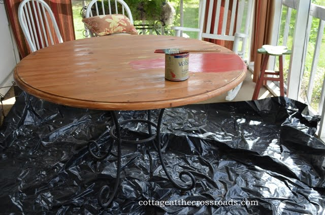 painting the table on the front porch