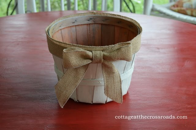 apple basket painted white with a burlap bow