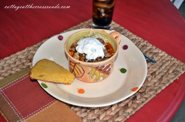 minted sour cream as a garnish on chili