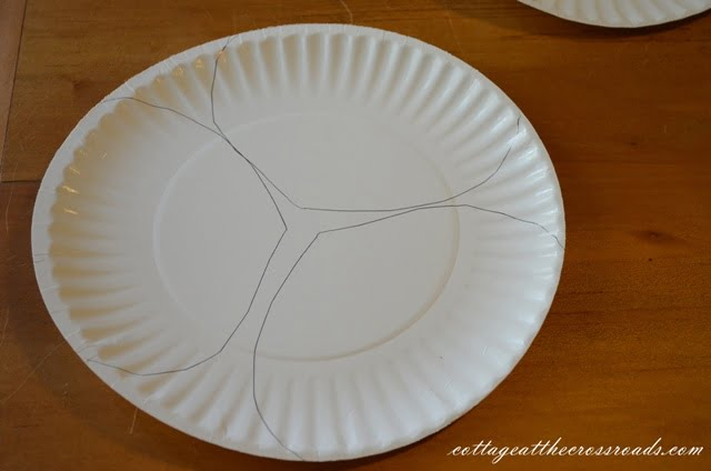 heads traced on a paper plate