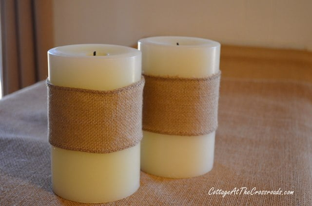 white candles wrapped in burlap