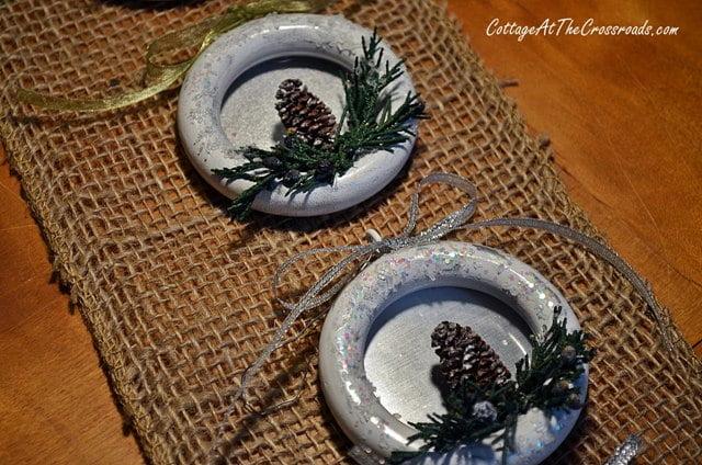 2 finished ornaments on burlap