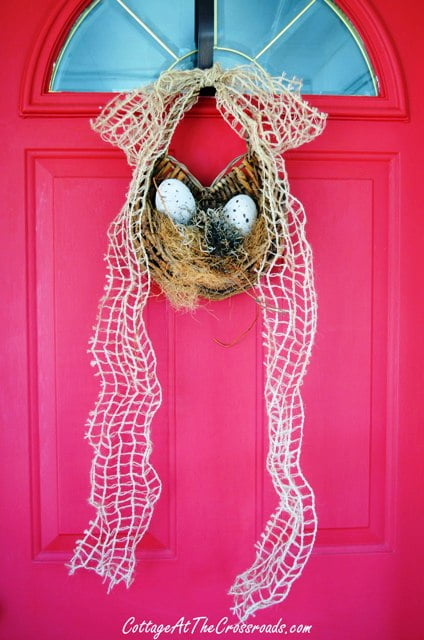 Easter door decoration with natural colored eggs
