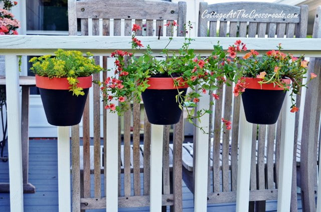 pots on deck railing attached with terralatch pot holder