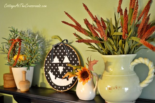 kitchen shelf decorated for fall