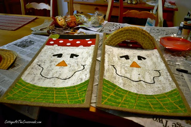 painted scarecrows on burlap