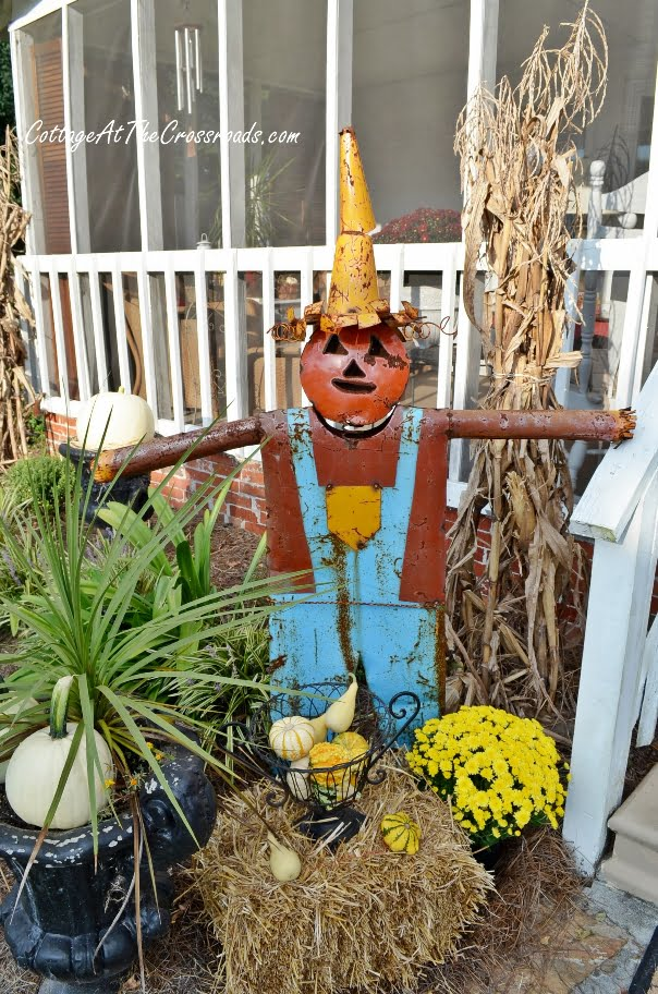 scarecrows on our fall porch