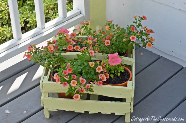 flowers in a wooden berry box | Cottage at the Crossroads