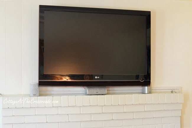 flat screen TV mounted above mantel | Cottage at the Crossroads
