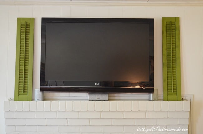 Using shutters to decorate around a flat screen TV | Cottage at the Crosssroads