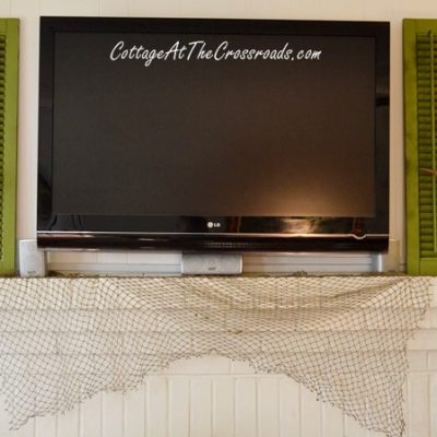 Using shutters to decorate around a flat screen TV | Cottage at the Crossroads
