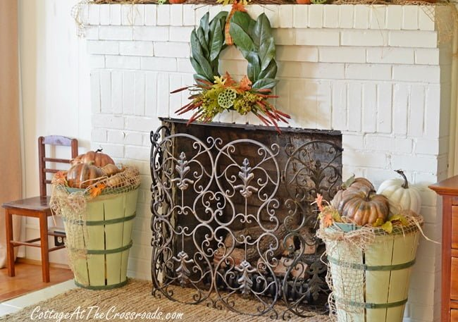 fall mantel with magnolia wreath and painted bushel baskets | Cottage at the Crossroads