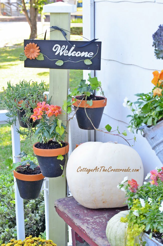 plant stand with hanging terracotta pots | Cottage at the Crossroads
