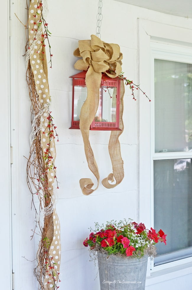 Summer wreath and garland on the front porch | Cottage at the Crossroads