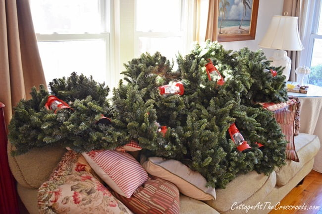 outdoor wreaths on sofa | Cottage at the Crossroads