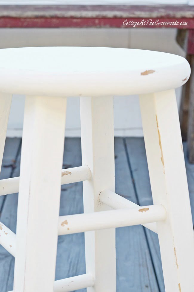 An ordinary wooden stool gets a cottage look when painted with chalky paint | Cottage at the Crossroads