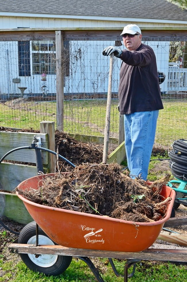 shoveling compost | Cottage at the Crossroads