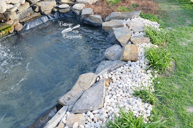 small stones around the garden waterfall | Cottage at the Crossroads