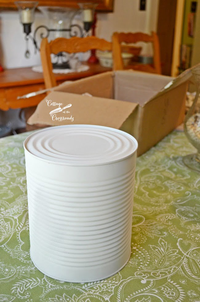 large aluminum can spray painted white