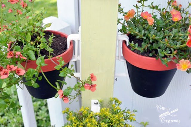 flower pots hung with terracotta pot holders | Cottage at the Crossroads