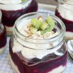 A light, blueberry cheesecake dessert in a jar