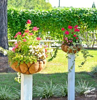 flower baskets mounted on wooden posts