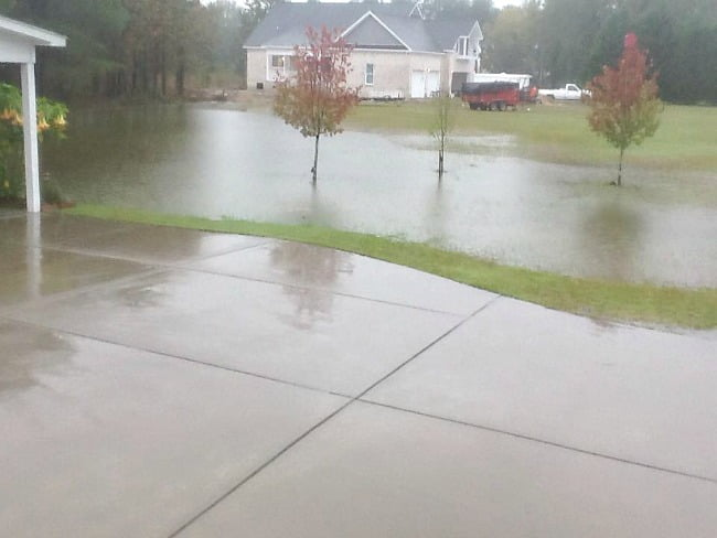 water standing in the yard | Cottage at the Crossroads