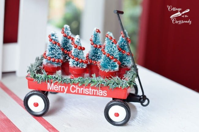 red wagon filled with Christmas trees