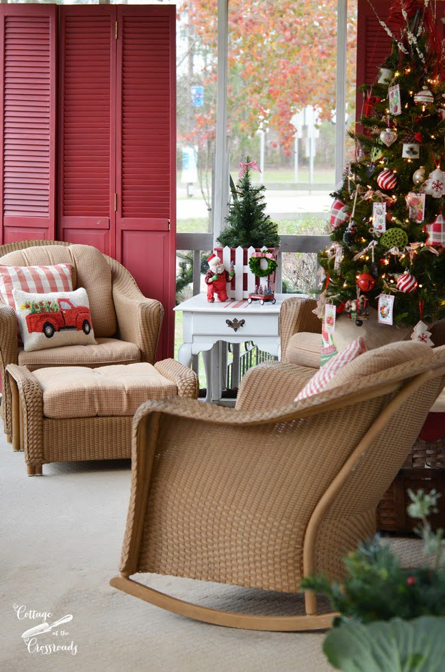 A cottage Christmas porch with a gardening theme