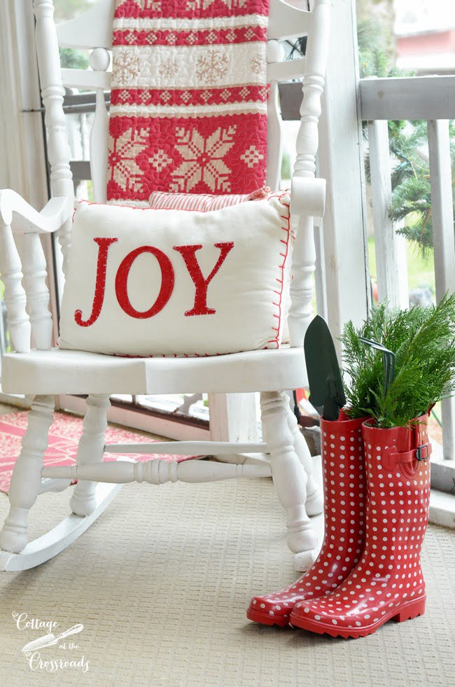 red gardening boots with Christmas pillow