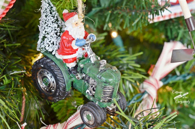 Santa on a tractor Christmas ornament