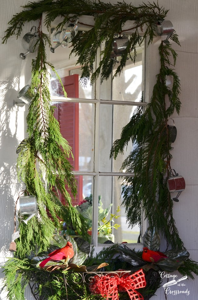 fresh Christmas garland around an old mirror