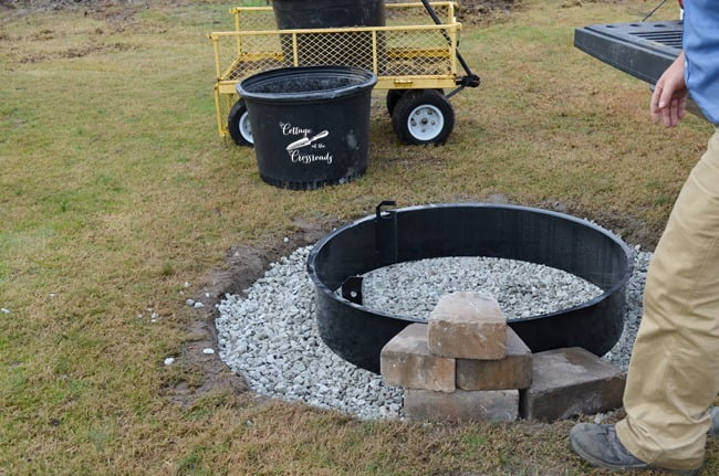 confirming the pattern of stones in Belgard fire pit install - Our New Belgard Outdoor Fire Pit - Cottage At The Crossroads