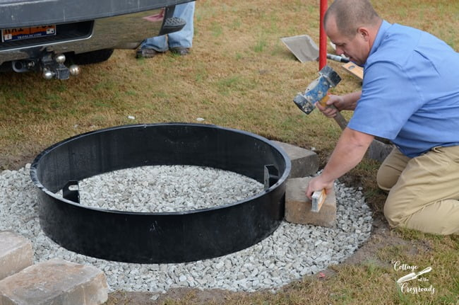leveling the stones in a Belgard fire pit installation