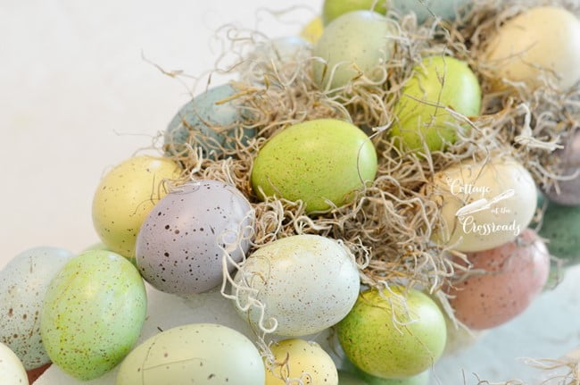 adding Spanish moss to an Easter egg topiary | Cottage at the Crossroads