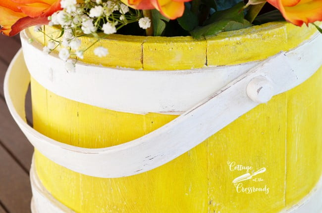 yellow wooden firkin bucket | Cottage at the Crossroads