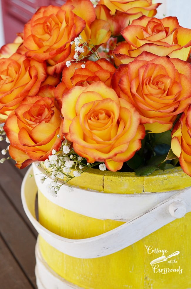 yellow painted wooden sugar bucket | Cottage at the Crossroads