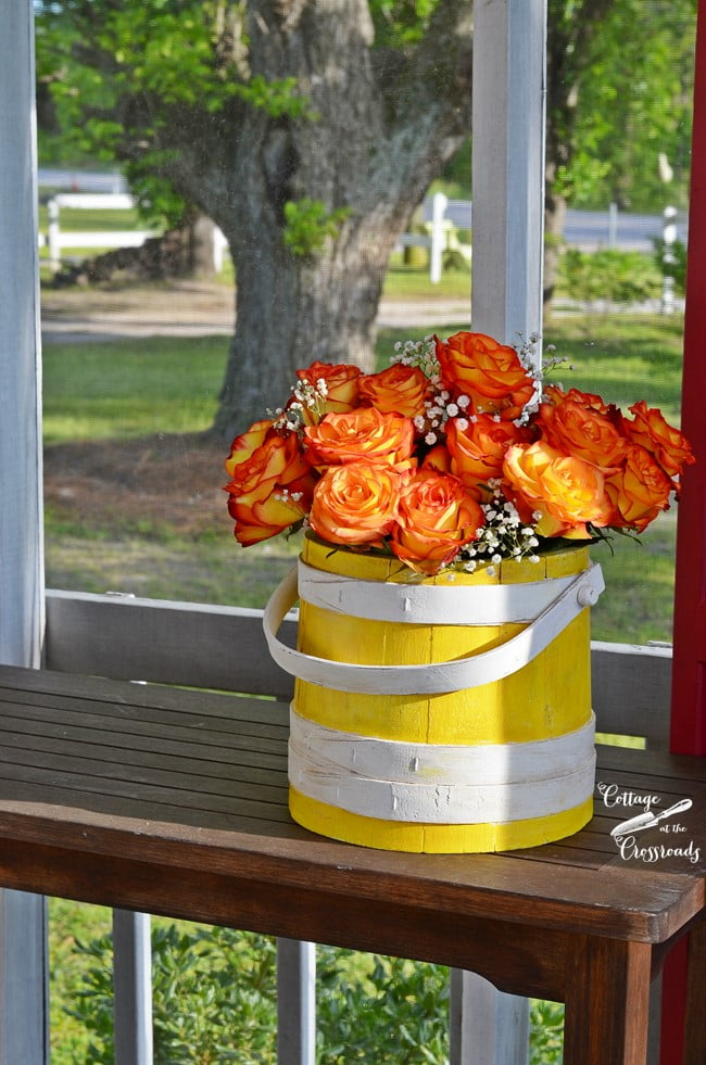 yellow painted wooden firkin bucket | Cottage at the Crossroads