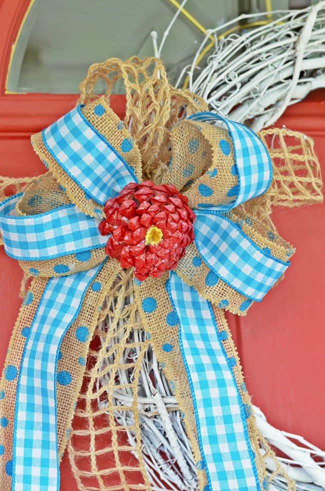 bow on summer wreath with pine cone zinnia flower