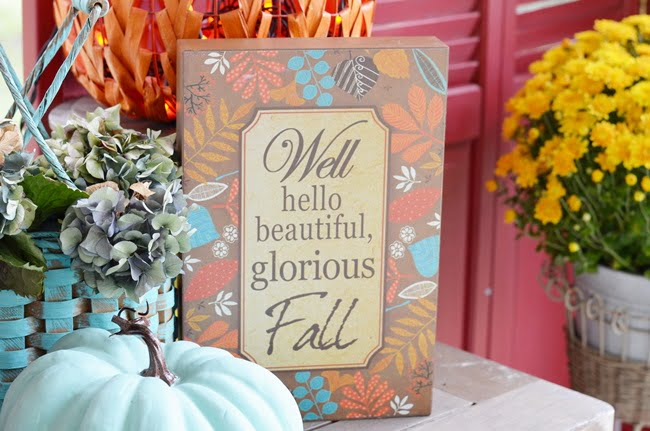 sign on a fall porch