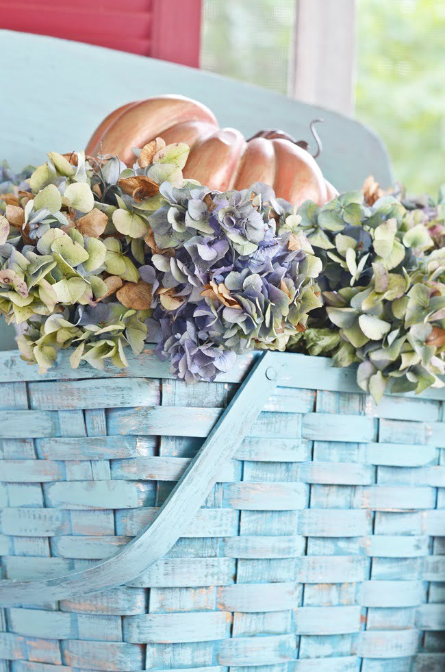 painted picnic basket with dried hydrangeas | Cottage at the Crossroads
