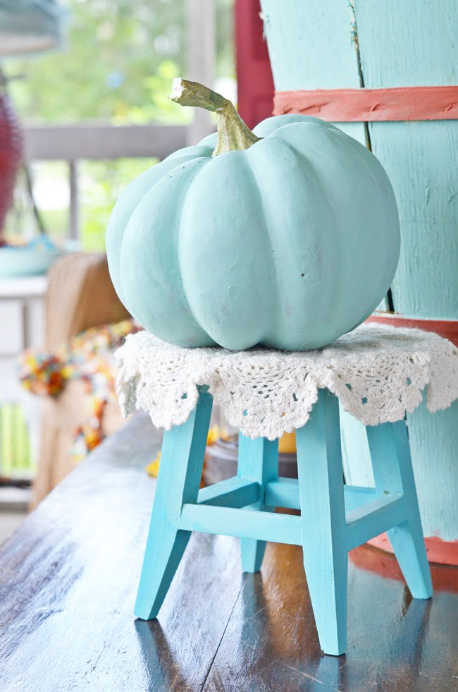 faux pumpkin on a fall porch