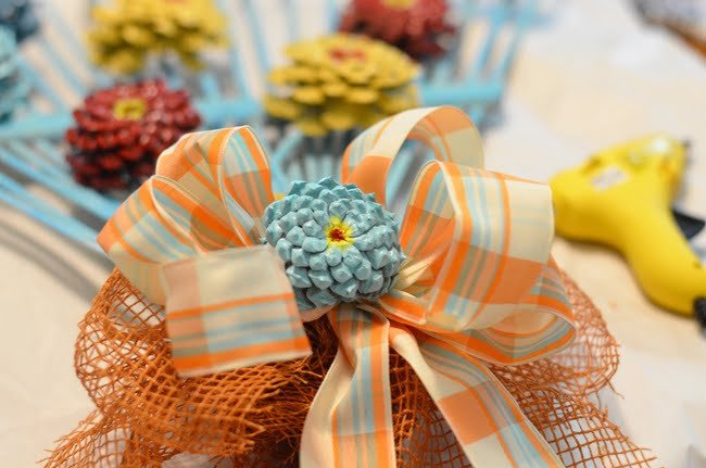 orange and aqua ribbon used on a rake wreath