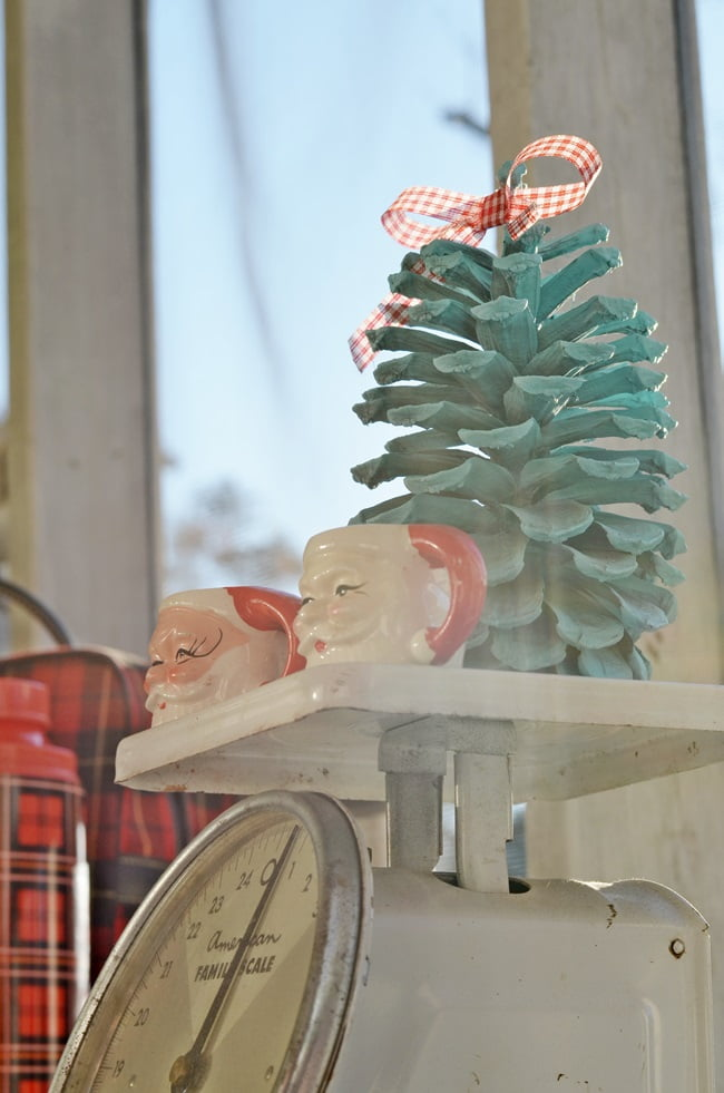 vintage Santa mugs on a Christmas porch