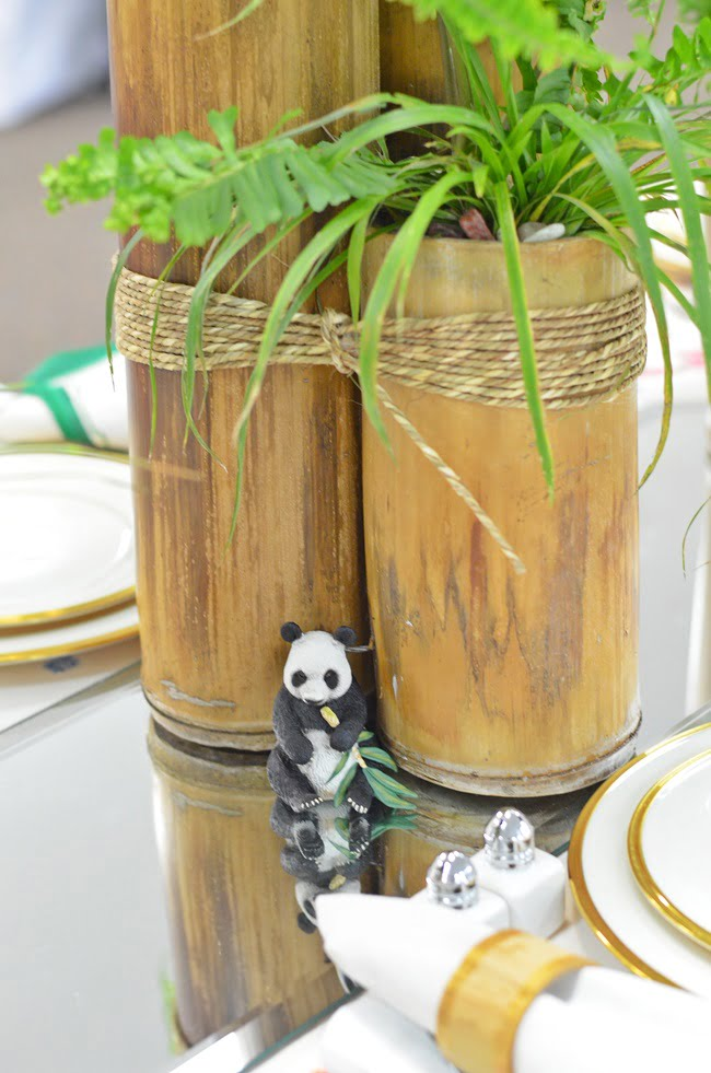 bamboo centerpieces on a nature inspired table