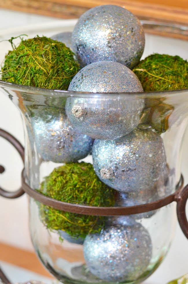 green moss balls mixed with blue ornaments