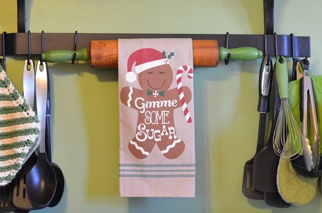 gingerbread kitchen towel hanging on a rolling pin | Cottage at the Crossroads