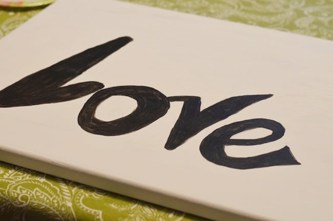 the word LOVE painted on a canvas