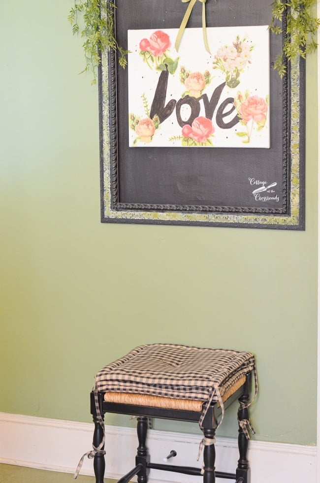 Valentine's Day decoupage art hanging on a chalkboard